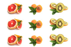 Grapefruit,apricot, slices of ripe kiwi with mint leaves Royalty Free Stock Images