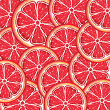 Grapefruit background from slices of juicy grapefr Royalty Free Stock Images