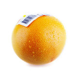 Grapefruit with bar code sticker and water drops Royalty Free Stock Image