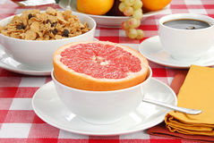 Grapefruit and bran flakes Stock Photography