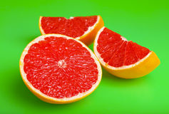 Grapefruit on bright green Stock Images