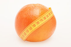 Grapefruit with centimeter Royalty Free Stock Images