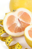 Grapefruit with centimetre. Royalty Free Stock Image