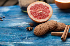 Grapefruit, cinnamon, oatmeal cookies on vintage a dark blue wooden background. Grapefruit, cinnamon and oatmeal cookies on vintage a dark blue wooden background royalty free stock photo