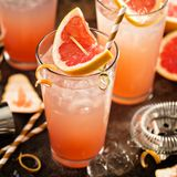 Grapefruit cocktail in tall glasses. With ice and sparkling water Royalty Free Stock Image