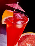 Grapefruit cocktail with umbrella 83 Royalty Free Stock Image
