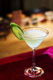 Grapefruit and cucumber martini cocktail drink in bar Royalty Free Stock Image