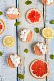 Grapefruit curd tartlets with meringue on top Royalty Free Stock Photos