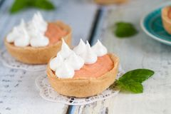 Grapefruit curd tartlets with meringue on top Royalty Free Stock Photo