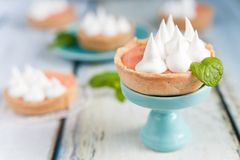 Grapefruit curd tartlets with meringue on top Royalty Free Stock Photography