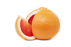 Grapefruit with the cut-out segment Stock Photos
