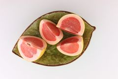 Grapefruit cut in slices Royalty Free Stock Photos