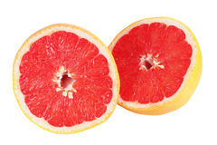 The grapefruit is cut on two parts Stock Images