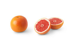 Grapefruit. A grapefruit and cut grapefruit on a white background Royalty Free Stock Images