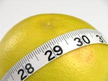 Grapefruit Diet. A measuring tape wrapped around a grapefruit Stock Photo