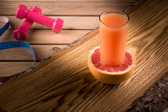 Grapefruit diet. Fresh grapefruit juice on a wooden board Stock Photography