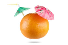 Grapefruit with drinking straw and umbrella isolated on white Royalty Free Stock Photography