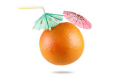 Grapefruit with drinking straw and umbrella isolated on white Stock Images