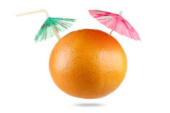 Grapefruit with drinking straw and umbrella isolated on white Stock Image