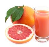 Grapefruit en sap. stock afbeelding