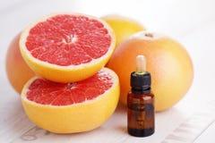 Grapefruit essential oil. Bottle of grapefruit essential oil - beauty treatment stock photos