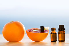 Grapefruit essential oils. In bottles Stock Photo