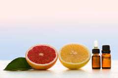 Grapefruit essential oils. In bottles Royalty Free Stock Photo