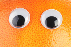 Grapefruit with eyes Stock Images
