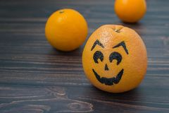 Grapefruit with a face drawn Royalty Free Stock Images