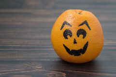 Grapefruit with a face drawn Stock Photo