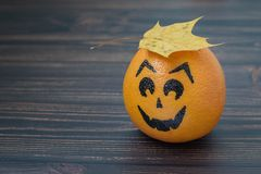 Grapefruit with a face drawn Royalty Free Stock Image