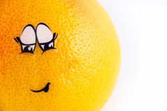Grapefruit with a face embarrassment Royalty Free Stock Images