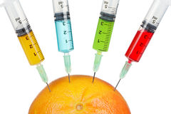 Grapefruit with four syringes Royalty Free Stock Photography