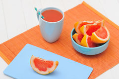 Grapefruit and freshly squeezed juice Stock Photos