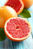 Grapefruit fruits. On a blue wooden table stock photos