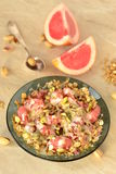 Grapefruit with granola, yoghurt and pistachios Royalty Free Stock Photos
