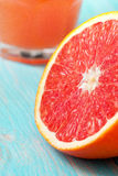 Grapefruit and grapefruit juice Royalty Free Stock Images