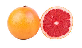 Grapefruit with half. Grapefruit with cut half on a white background Royalty Free Stock Image