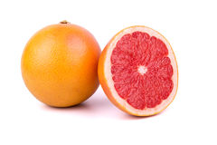 Grapefruit with half. Grapefruit with cut half on a white background Stock Photography