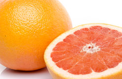 Grapefruit and half grapefruit Royalty Free Stock Photos