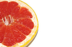 Grapefruit with a half and piece on white background Stock Photos