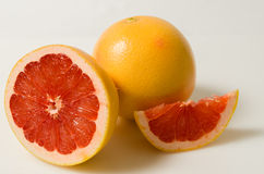 Grapefruit with a half and piece Royalty Free Stock Image