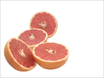 Grapefruit Halves. Colorful and heathy pink grapefruit haves isolated over white Stock Image