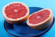 Grapefruit halves close-up Stock Images