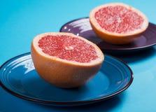 Grapefruit halves close-up on a plate o Stock Photography