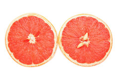 Grapefruit halves cutout. Cutout of grapefruit cut in half showing both halves Royalty Free Stock Image