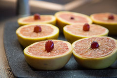 Grapefruit Halves Garnished with Grapes Royalty Free Stock Image