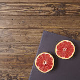 Grapefruit halves. On a wooden background Royalty Free Stock Image