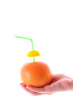 Grapefruit in hand Stock Image