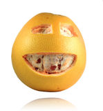 Grapefruit with happy face Stock Photos